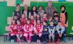 Dagli anziani di Cairate grembiuli in regalo agli asili del paese